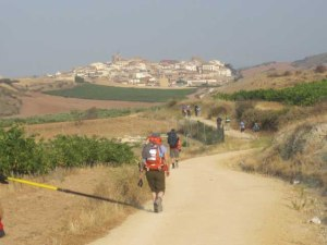 Pilgrims approach the town of Cirauqui.