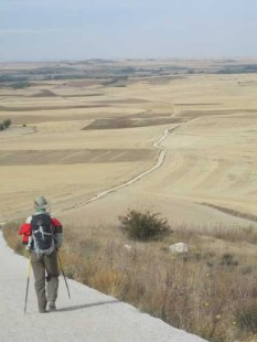 A pilgrim descends into the Meseta a flat, open section of the Camino that takes days to cross.